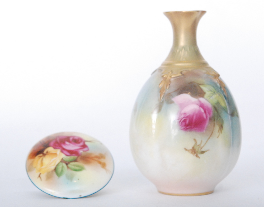 Lot 45 - A small Royal Worcester 'Hadley's Roses' bud vase decorated with hand painted pink and crimson