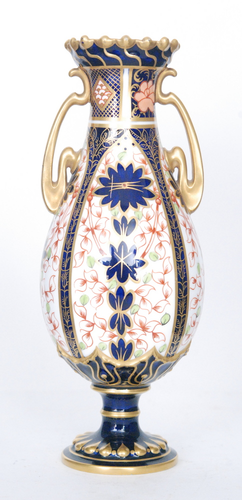 Lot 50 - A Royal Crown Derby twin handled vase decorated in the Imari 1128,