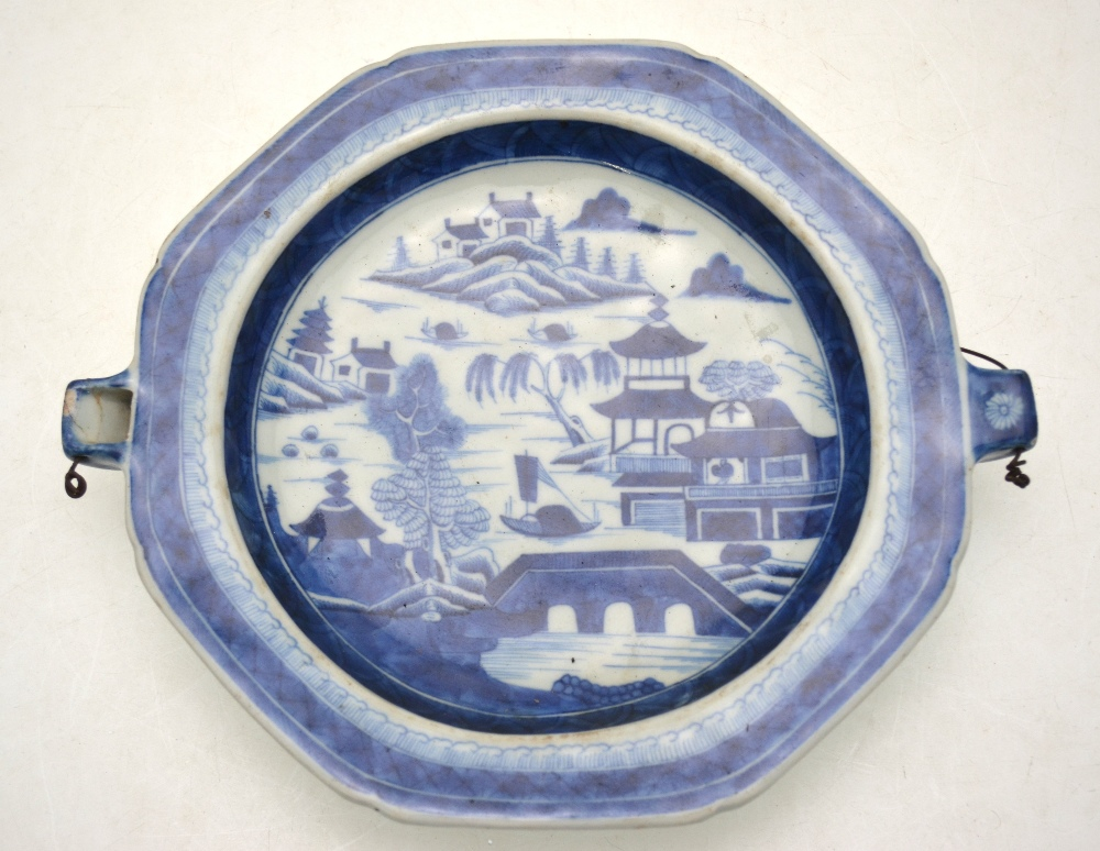 Lot 17 - A Chinese export blue and white plate warmer decorated with a coastal landscape, 18th/19th century,