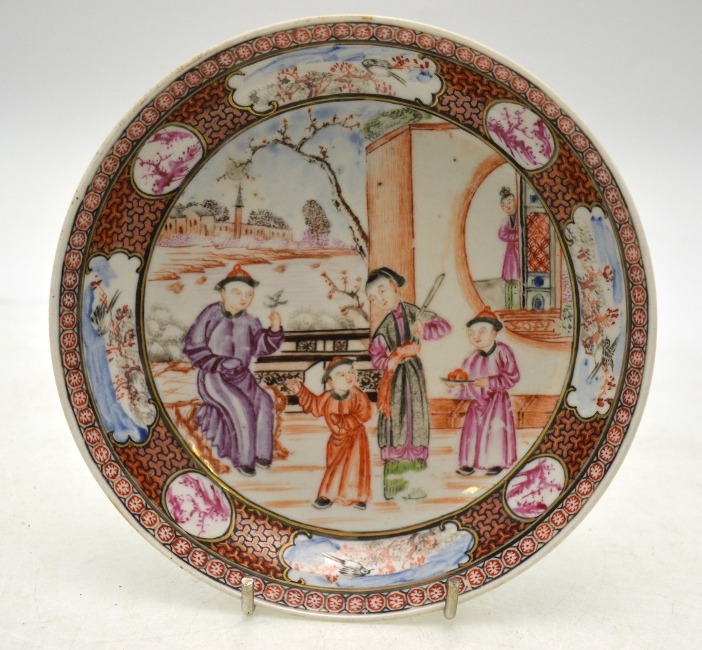 Lot 22 - A Chinese 18th century saucer dish decorated in the Mandarin palette with figures on a terrace,