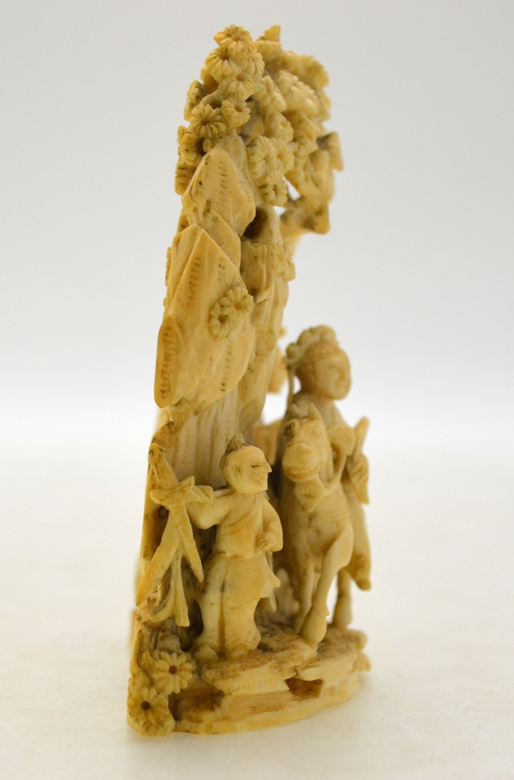 Lot 39 - A small Chinese Canton ivory carving depicting an aristocratic lady mounted on a horse on a rocky