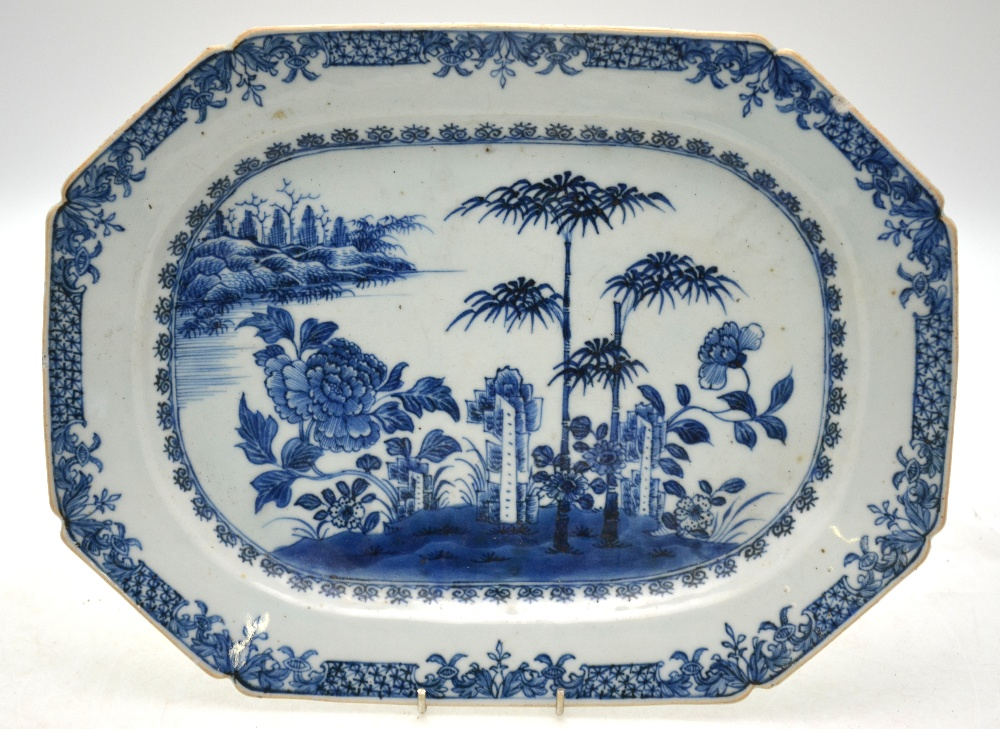 Lot 25 - A Chinese blue and white chamfered rectangular meat dish decorated with rockwork,