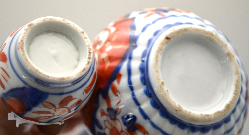 Lot 4 - A pair of Japanese Imari vases decorated with floral designs, 25.5 cm h.