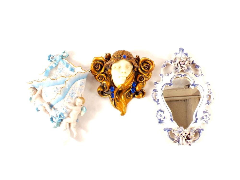 Lot 8 - A continental porcelain cherub wall pocket (as found),