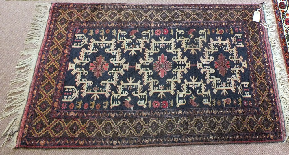 Lot 53 - A Belouchi blue ground rug,