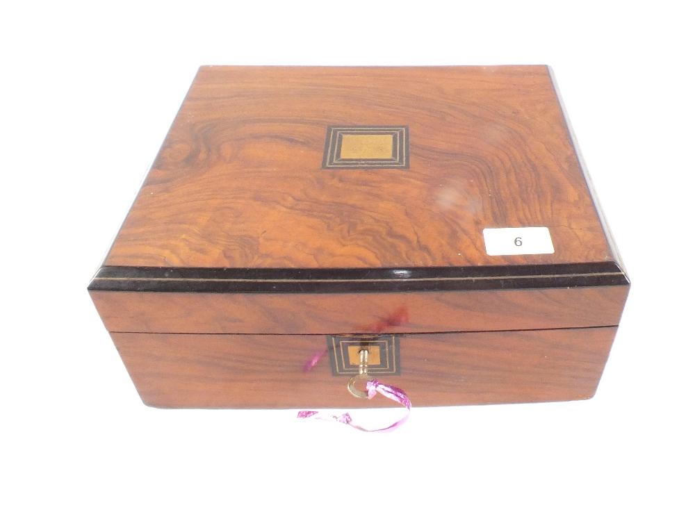 Lot 6 - A Victorian walnut and ebonised work box