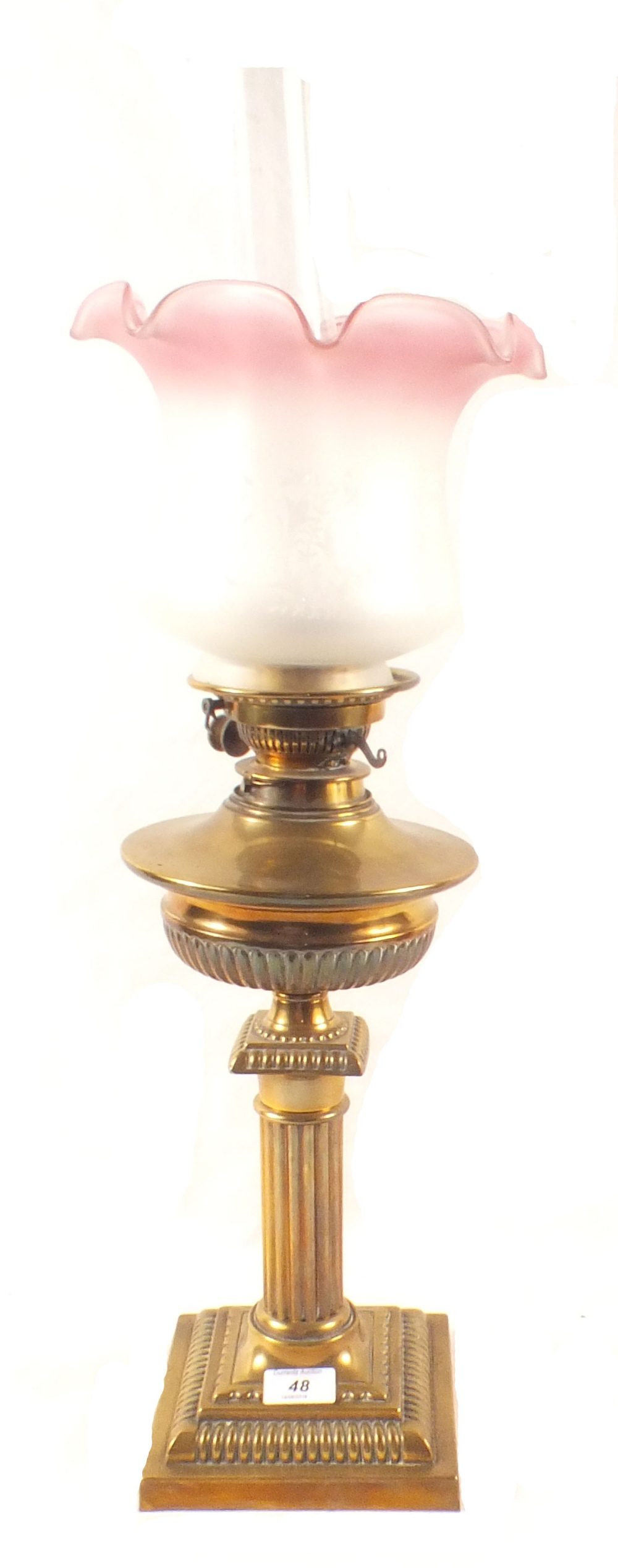 Lot 48 - A brass column oil lamp with etched glass shade