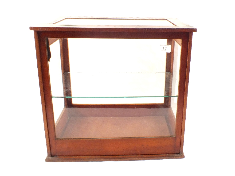 Lot 13 - A mahogany glazed rising front table display cabinet