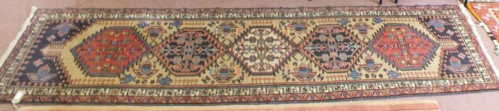 Lot 52 - A Persian geometric runner,