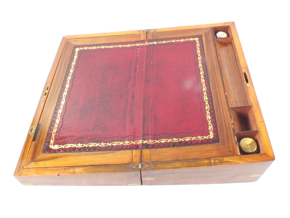 Lot 7 - A Victorian walnut and brass writing slope