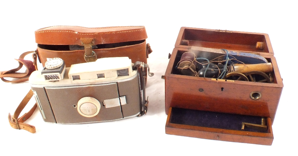 Lot 12 - A mahogany cased electric shock machine plus an early Polaroid camera