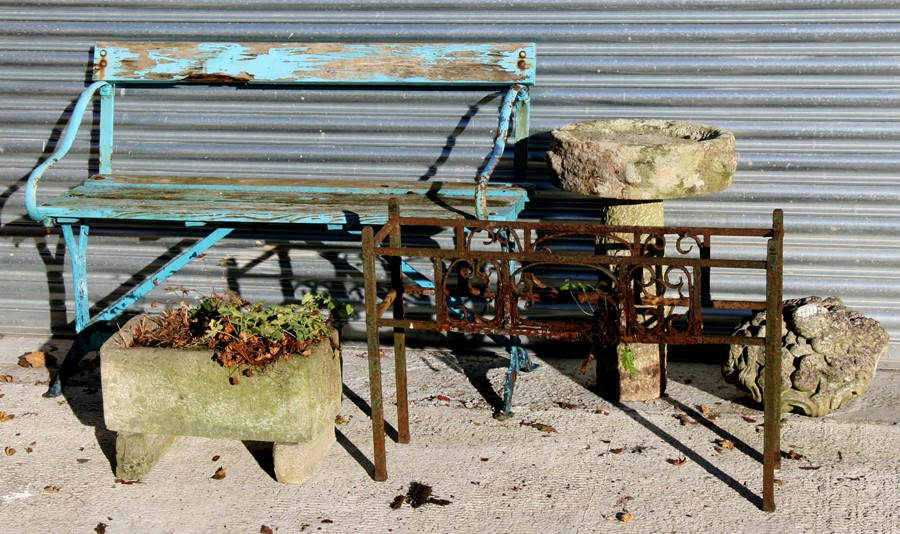 Lot 4 - A wrought iron two-seater garden bench; a stoneware planter; a stoneware two-part bird bath; and
