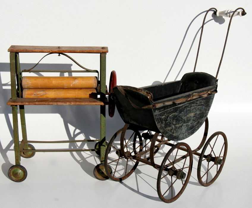 Lot 37 - A child's Triang toy mangle; together with a painted wooden dolls pram (2).