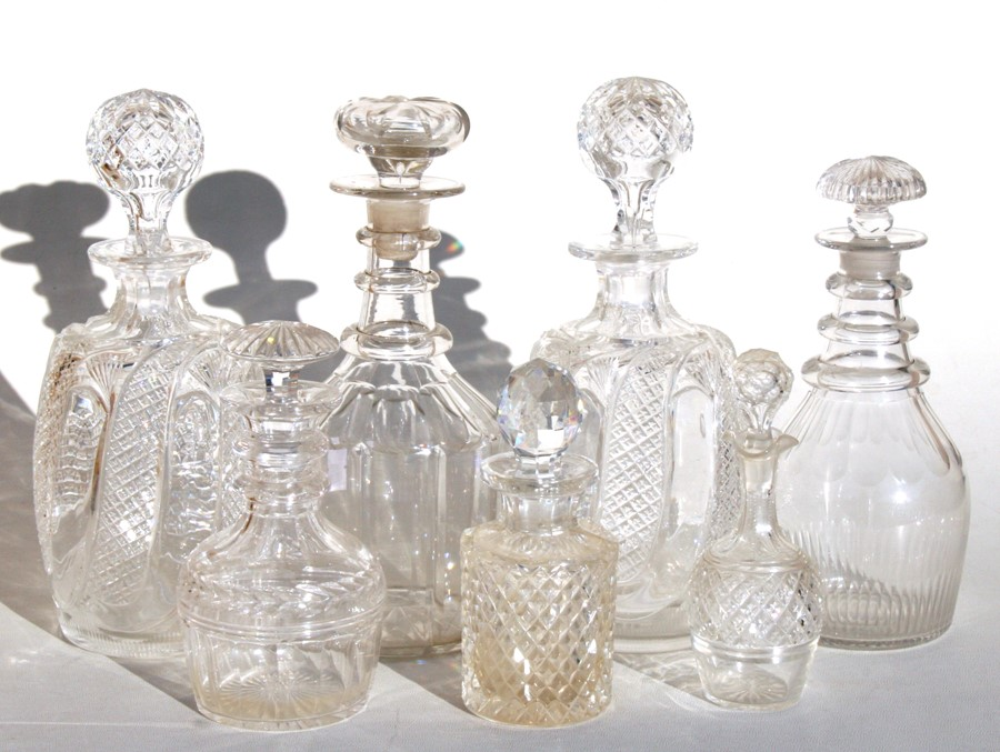 Lot 10 - A pair of 19th century cut glass decanters, 26cms (10.25ins) high; together with other Georgian