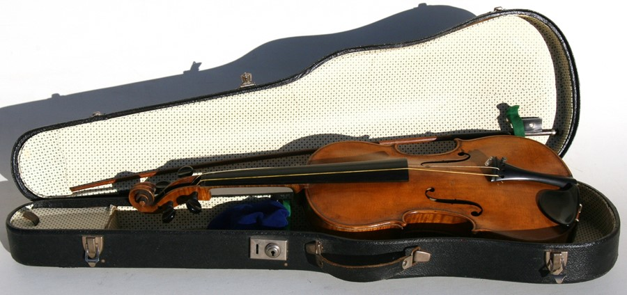 Lot 50 - A two-piece backed violin and bow, bears spurious label Stradivarius, cased, 59cms (23.25ins)