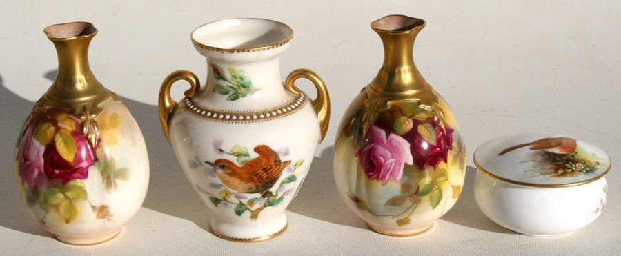 Lot 20 - A pair of Royal Worcester vases decorated with roses, 19cms (4ins) high; together with a Royal