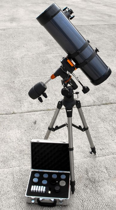 Lot 59 - A Celestron Astro Master 130 telescope on stand with case of extra lenses.
