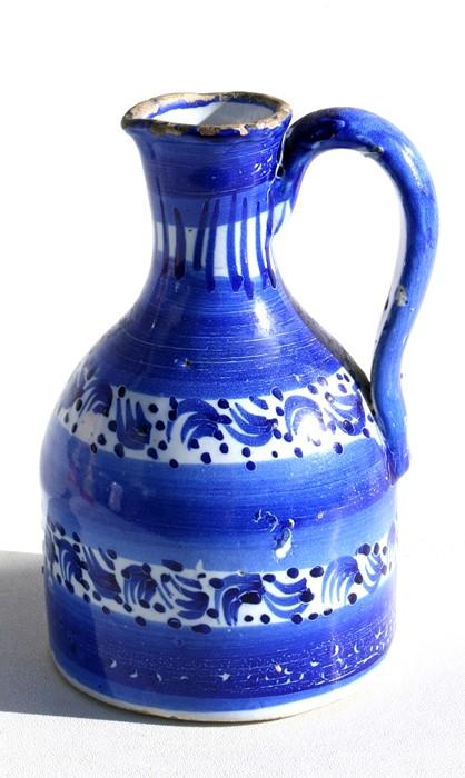 Lot 26 - A 19th century Delft jug, 14cms (5.5ins) high.