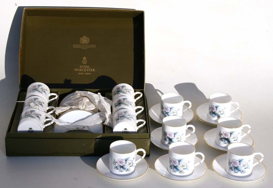 Lot 19 - A boxed set of Royal Worcester coffee cans & saucers; together with seven unboxed matching coffee