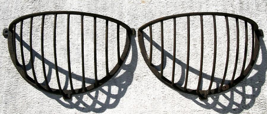 Lot 9 - A pair of cast iron hay racks.