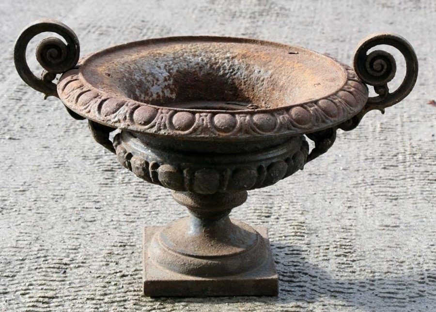 Lot 6 - A cast iron two-handled planter, 39cms (15.25ins) diameter.
