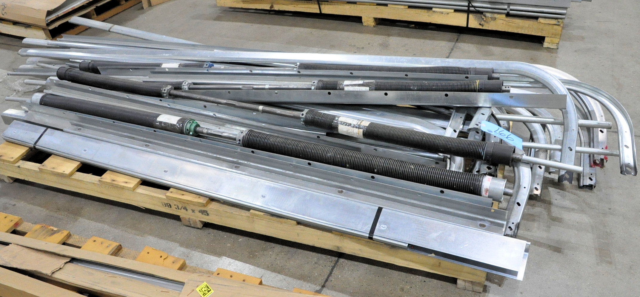 Lot-Overhead Truck Door Springs and Tracks on (1) Pallet