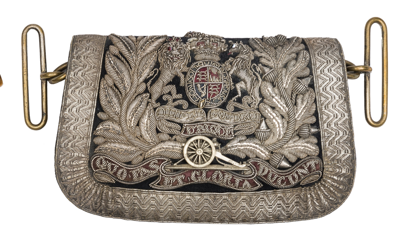 Lot 24 - A Victorian officer's pouch of the Volunteer Artillery, of blue cloth, silver lace border, the
