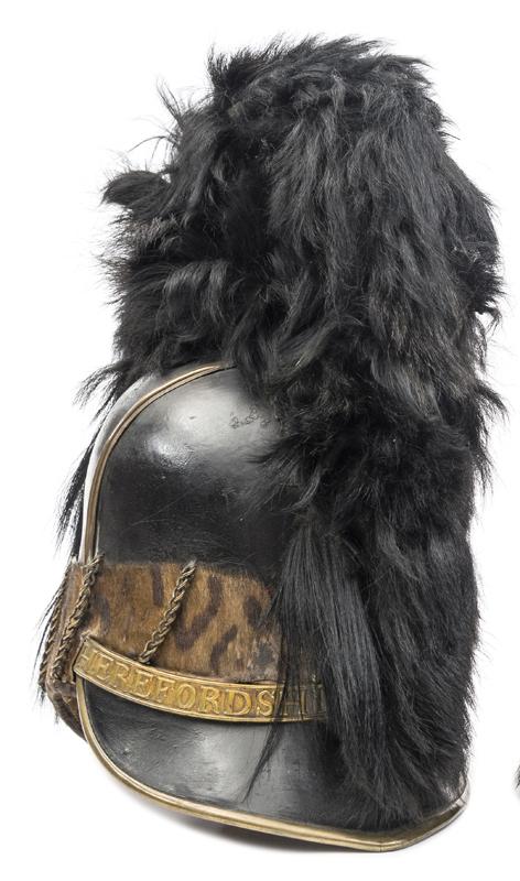 Lot 52 - A rare Georgian officer's Tarleton helmet of the Herefordshire Yeomanry, black leather skull, animal