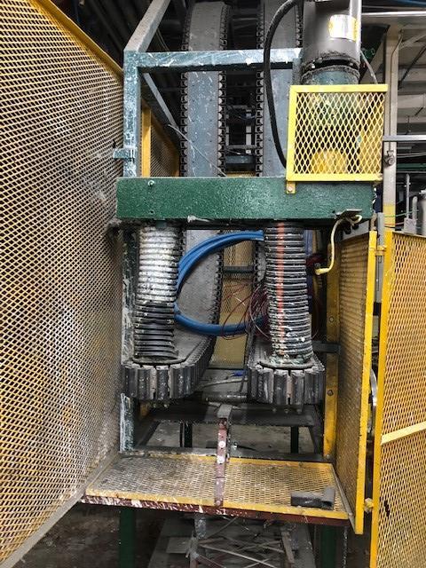 Empty gallons lowering conveyor Rago line