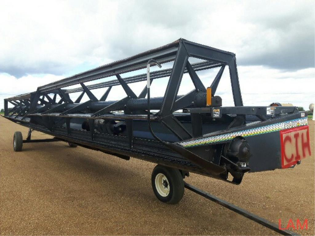 Lot 21 - 960 Macdon 36ft Straight Cut Header Fits on Case IH 1680 – 2388c/w batt reel, factory transport