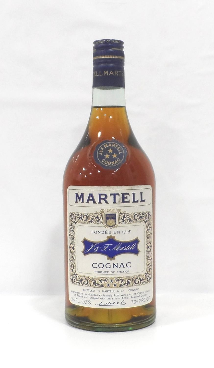 Lot 8 - MARTELL 3 STAR COGNAC CIRCA 1970 An older bottle of Martell 3 star Cognac from the early 1970s. 24
