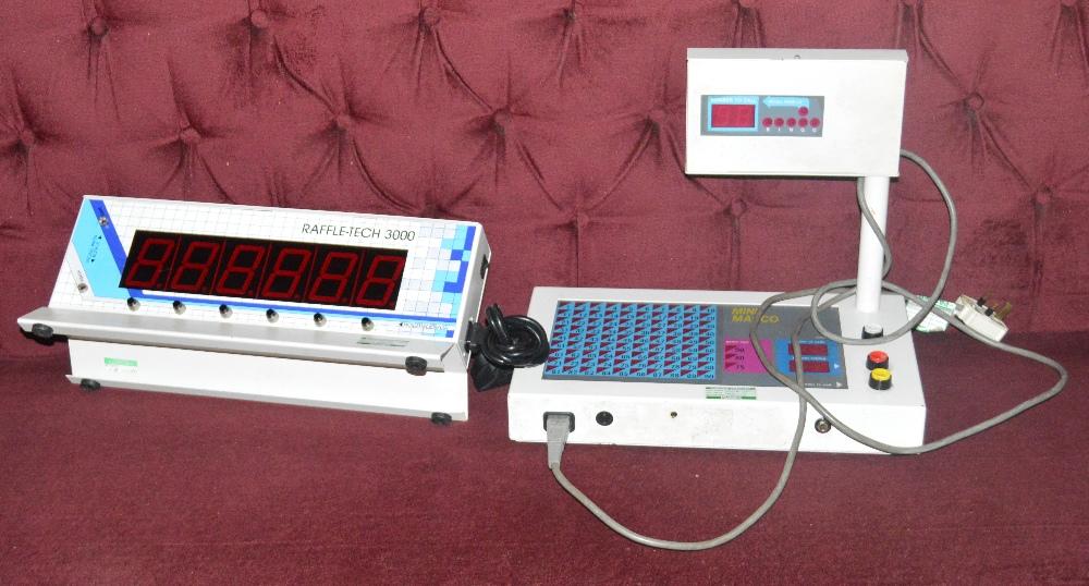 A Raffletech 3000 and a Mini Marco bingo machine (2).
