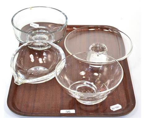 Three pieces of Steuben art glass together with a similar pedestal bowl