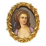 λ Continental School 19th Century Portrait miniature of a lady, head and shoulders Oval in a leaf
