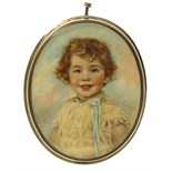 λ J.S.W. (c. 1900) Portrait miniature of a boy, half length Signed with initials Oval in a silver