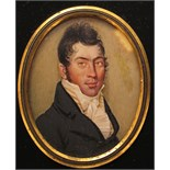λ English School early 19th Century Portrait miniature of a gentleman, head and shoulders Oval, in