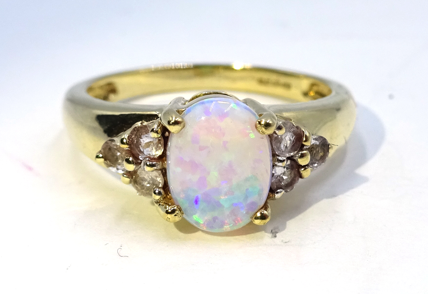 Lot 1041 - 9ct gold opal and white topaz ring,