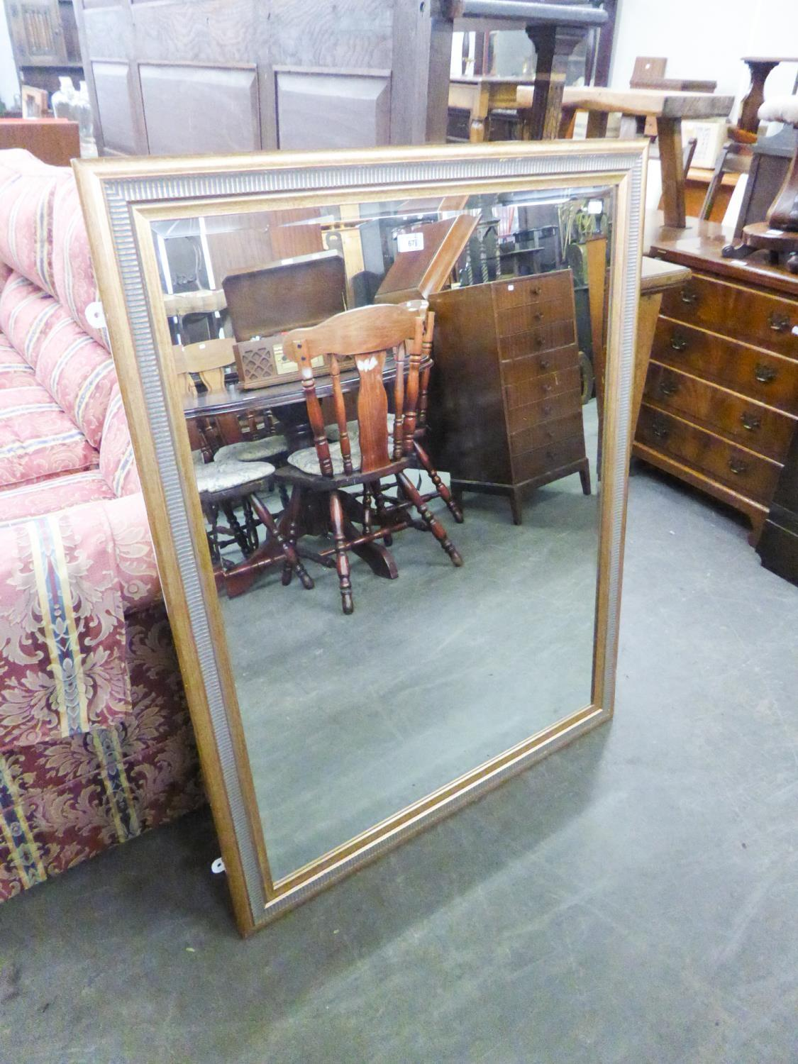 "Lot 14 - A LARGE, OBLONG BEVELLED EDGE WALL MIRROR IN FLUTED GILT FRAME, 3'9"" WIDE"