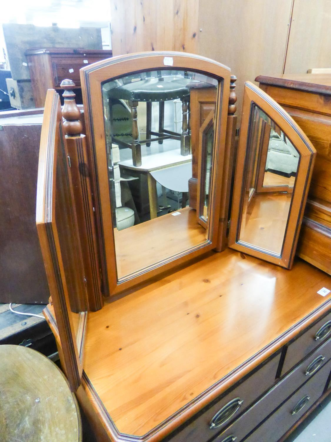 Lot 28 - DUCAL PINE DRESSING TABLE, MIRROR AND STOOL AND A BEDSIDE CUPBOARD (4)