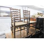 A SET OF SIX OAK LADDER BACK DINING CHAIRS WITH RUSH SEATS (4 +2)
