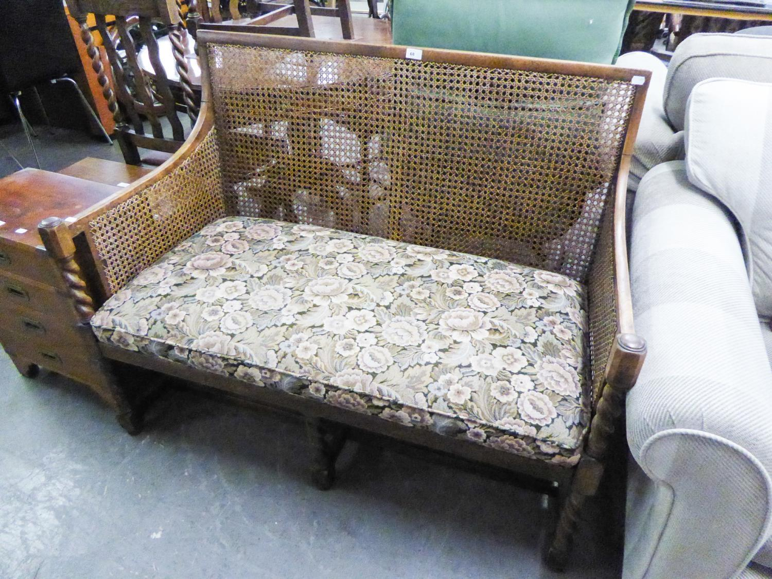 Lot 68 - AN OAK TWO SEATER SETTEEE WITH WICKER BACK AND ARMS RAISED ON BARLEY TWIST SUPPROTS