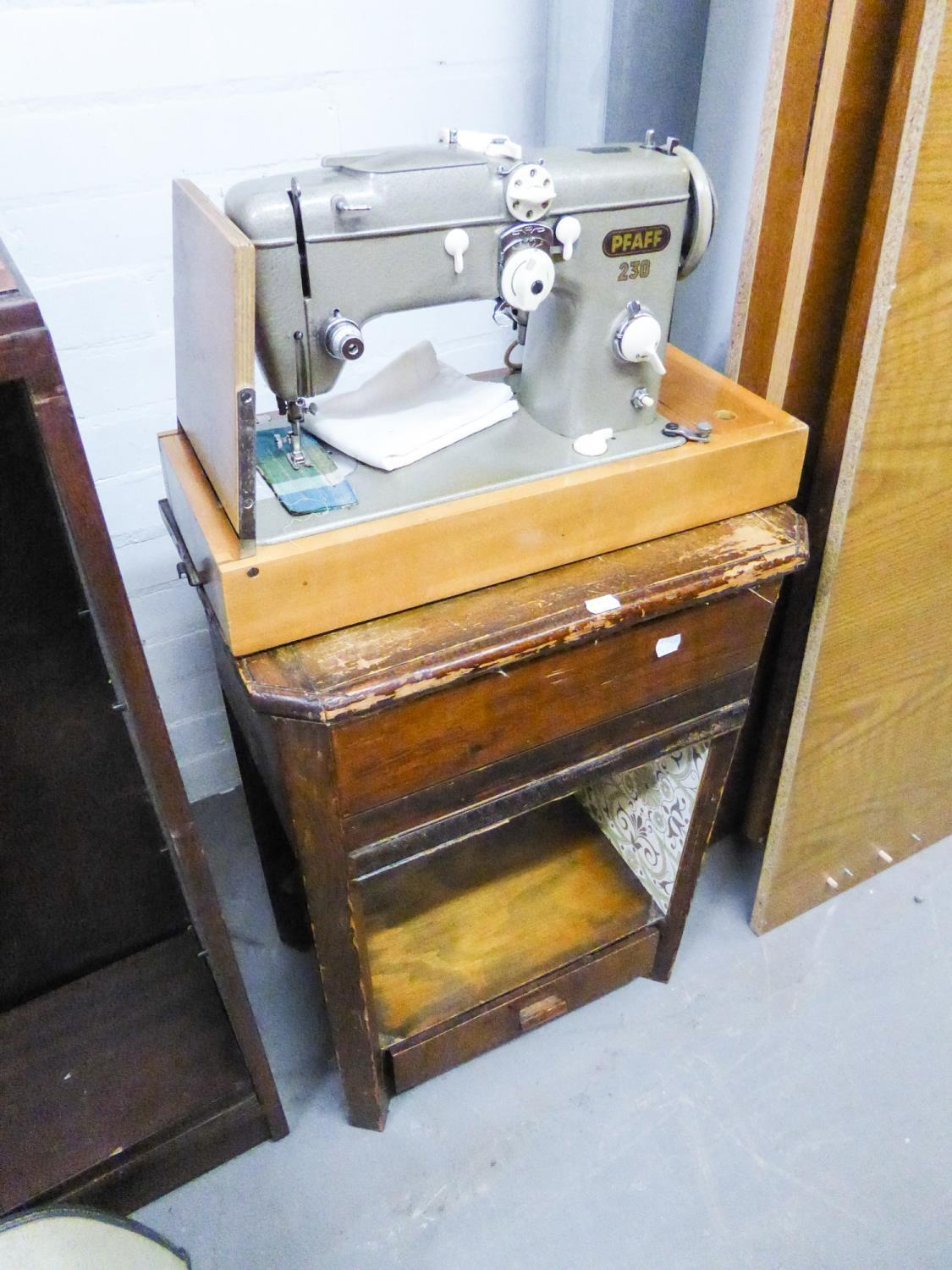 Lot 42 - AN ELECTRIC PORTABLE SEWING MACHINE WITH STAND