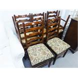 A SET OF EIGHT 1970's STAINED PITCH PINE LADDER BACK SINGLE DINING CHAIRS (8)