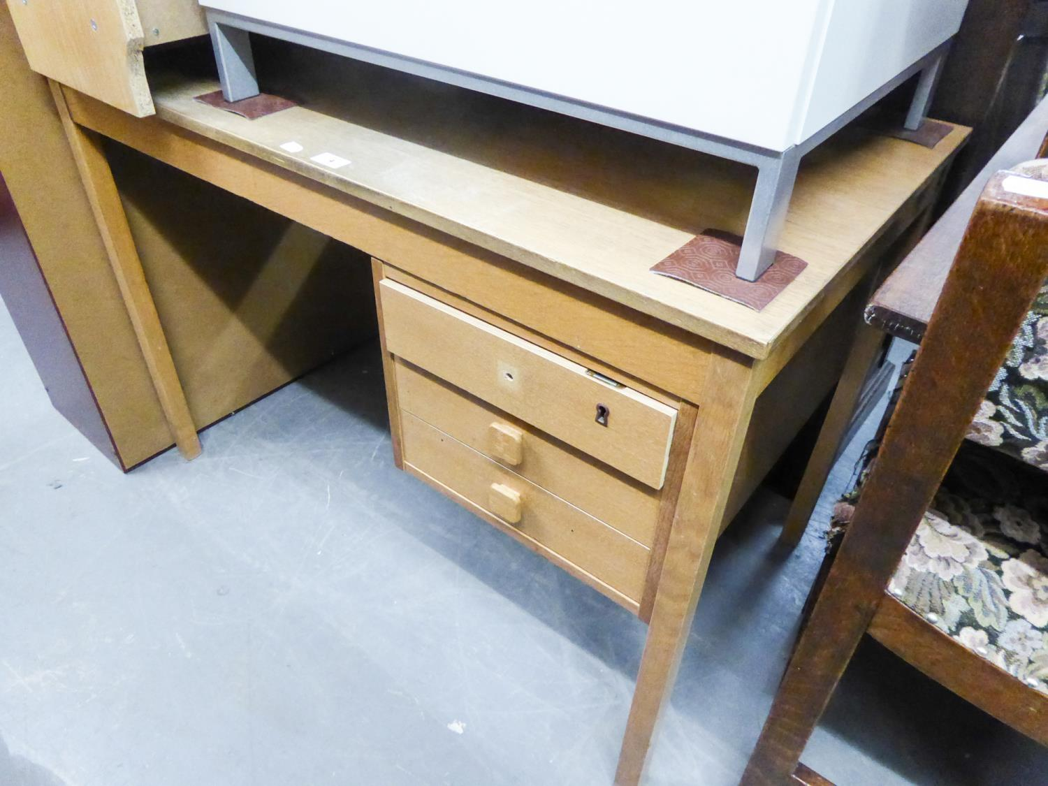 Lot 4 - A LIGHT WOOD MODERN DESK, WITH FITTED THREE DRAWER PEDESTAL AND A LIGHT WOOD MODERN BOOKCASE (2)