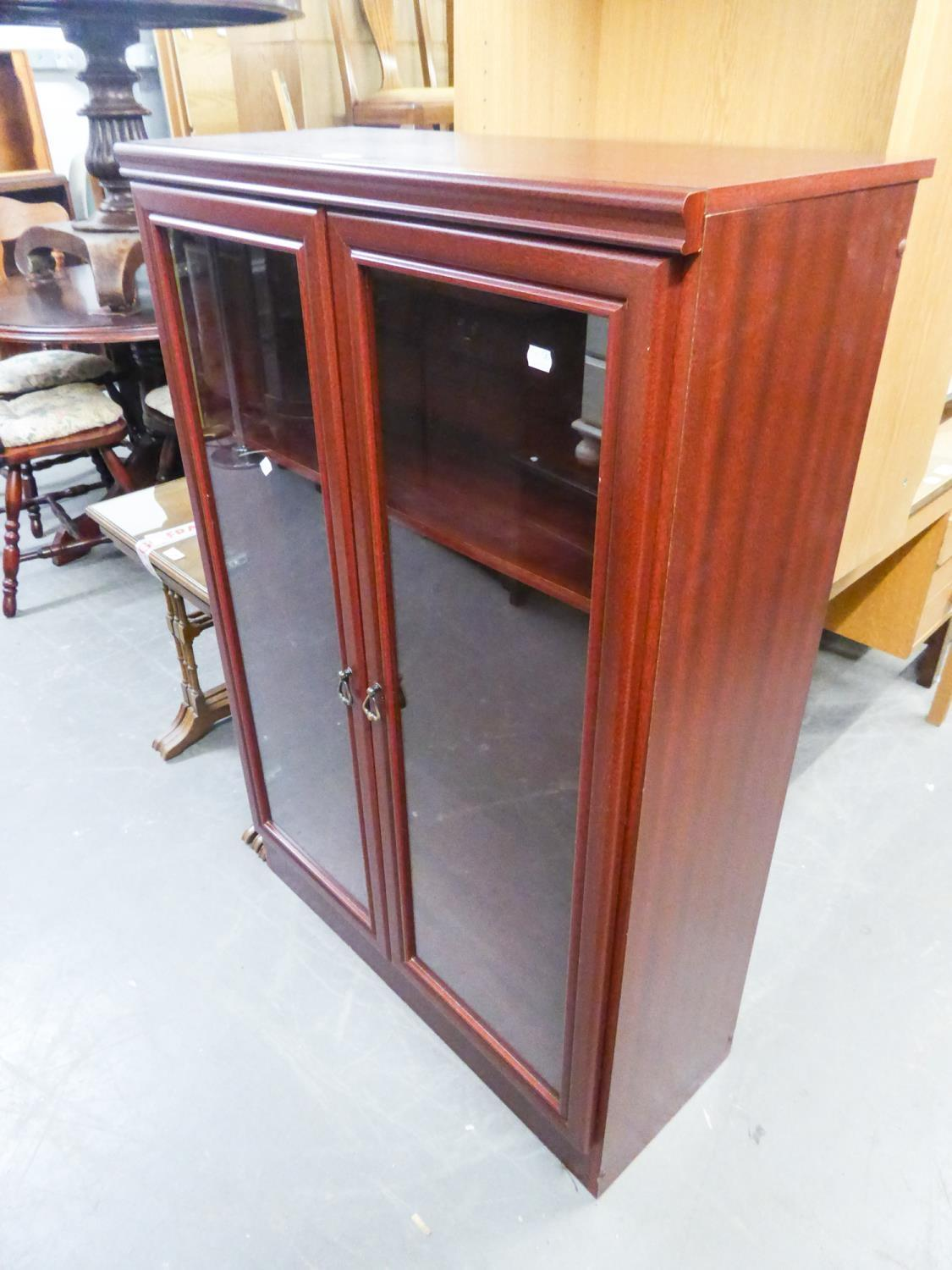 REPRODUCTION BOOKCASE HAVING TWO GLAZED DOORS, ENCLOSING TWO SHELVES