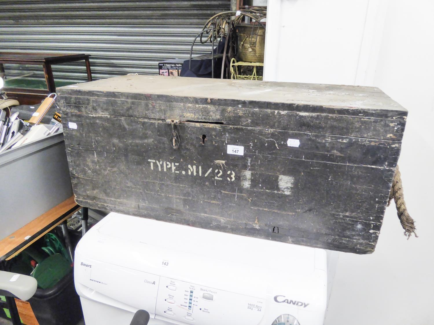 Lot 147 - A BLACK WOODEN AMMUNITION BOX WITH END ROPE HANDLES