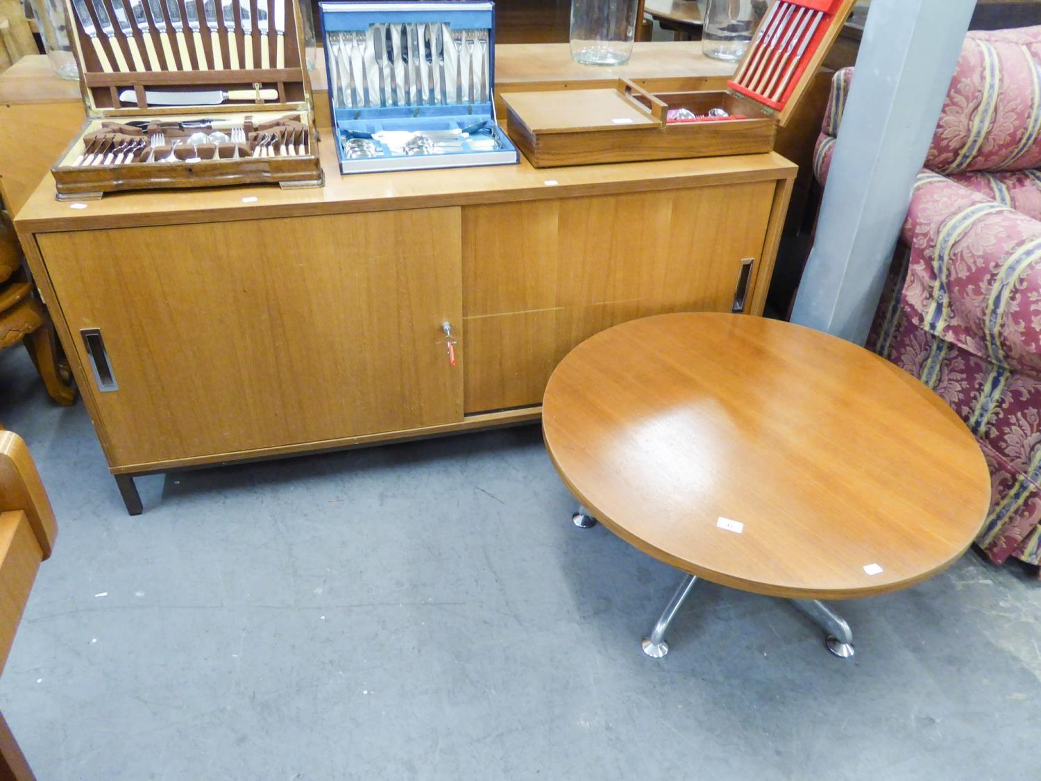 TEAK 'PROJECT' SIDEBOARD HAVING TWO SLIDING DOORS AND A CIRCULAR TOPPED COFFEE TABLE ON FIVE