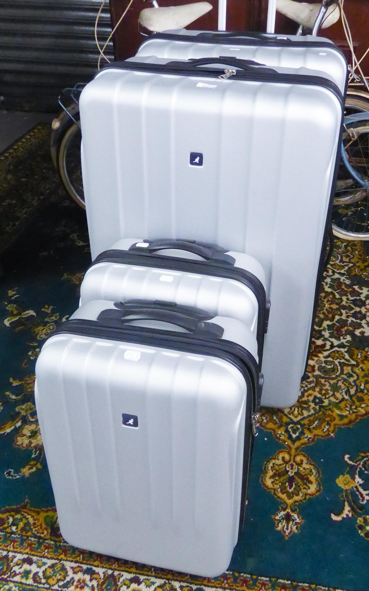 Lot 171 - TWO PAIRS OF KANGOL HARD BODIED SILVER COLOURED SUITCASES, 82cm x 55cm x 31cm and 54cm x 36cm x