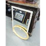 """AN OBLONG BEVELLED EDGE WALL MIRROR, IN WHITE AND GILT EMBOSSED FRAME, 17 1/2"""" X 28"""" AND AN OVAL"""