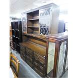 JACOBEAN STYLE CARVED OAK WELSH DRESSER, THE RAISED PLATE RACK FLANKED BY TWO LEAD LIGHT CUPBOARD